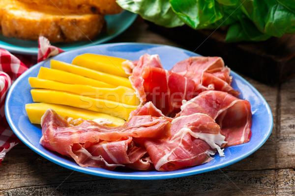 Prosciutto and mango.selective focus. Stock photo © zoryanchik