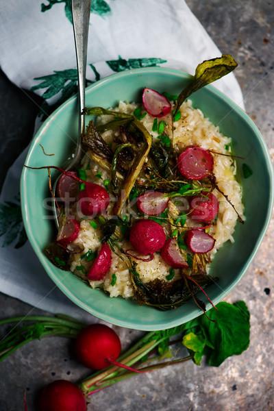 Roasted radish risotto  in  blue dish Stock photo © zoryanchik