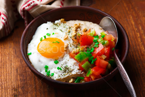Savory Oatmeal with Cheddar and Fried Egg Stock photo © zoryanchik