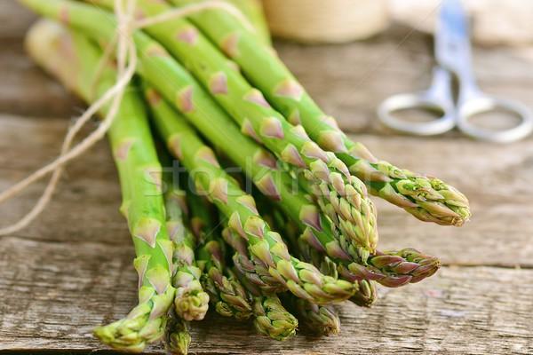 bunch of raw, green asparagus Stock photo © zoryanchik