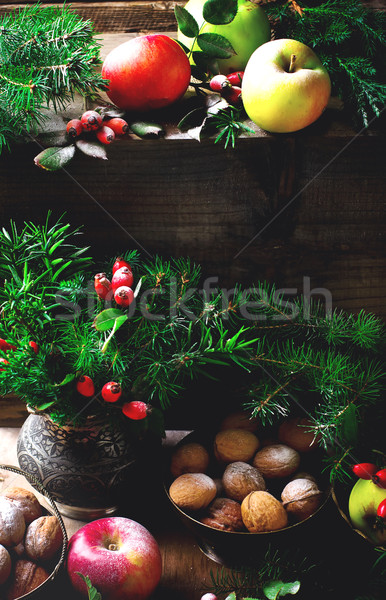 New Year's still life with apples, nuts and fir-tree branches.  Stock photo © zoryanchik