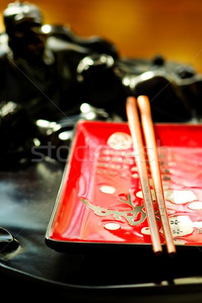 Boş Çin seramik plaka Çin yemek çubukları seçici odak Stok fotoğraf © zoryanchik