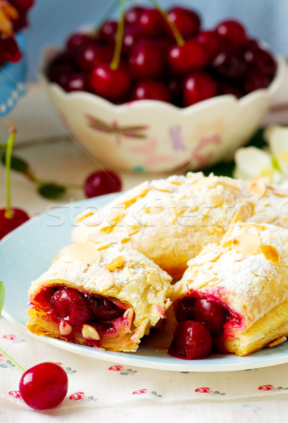 Pies from puff pastry with cherry Stock photo © zoryanchik