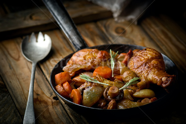 Stock photo: chicken with mushrooms and vegetables, stewed in wine.