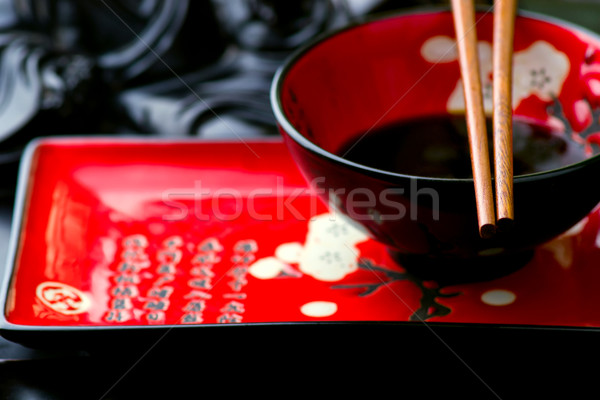 empty ceramic Chinese dish and chopsticks Stock photo © zoryanchik