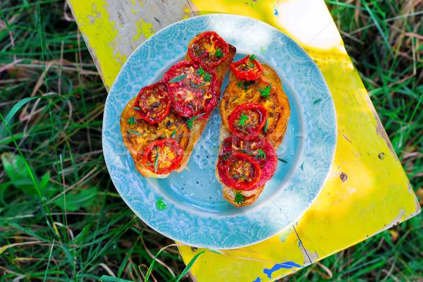 bruschetta with baked tomato Stock photo © zoryanchik
