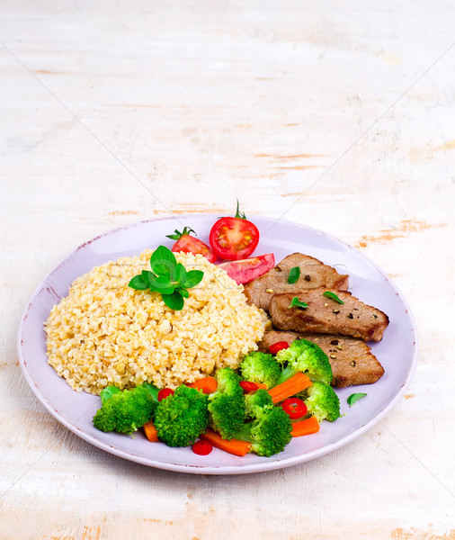 Steak  with bulgur and vegetables Stock photo © zoryanchik
