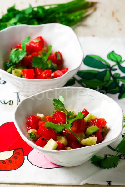 Tomato cucumber salsa in ceramic bowl. Stock photo © zoryanchik