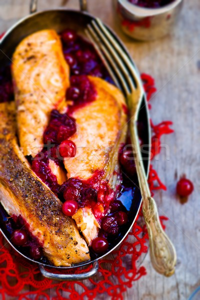 fried fillet of a salmon with cranberry sauce  Stock photo © zoryanchik