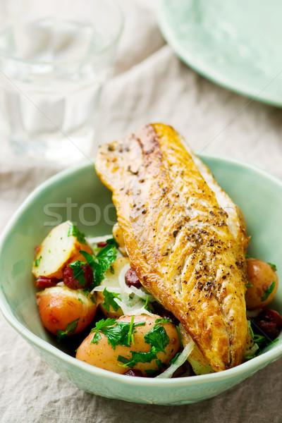 fried mackerel with potatoes in a bowl Stock photo © zoryanchik