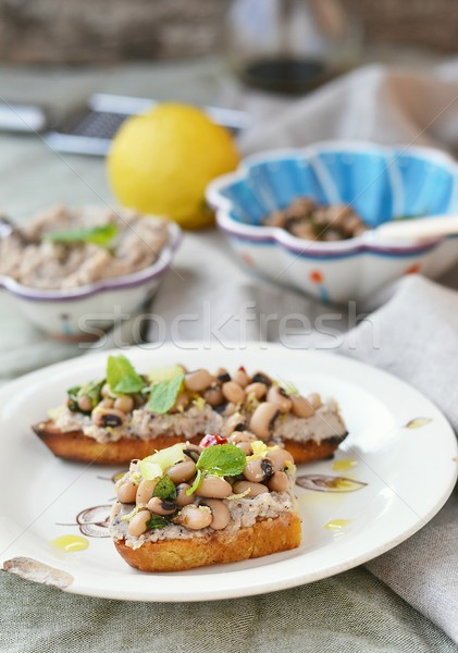 Bruschetta fasulye ahşap gıda plaka salata Stok fotoğraf © zoryanchik