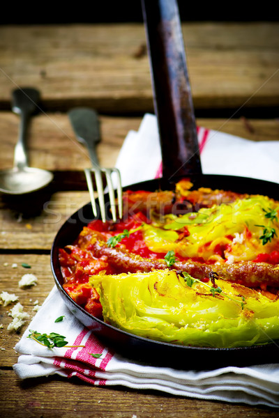 The baked cabbage with sausages  Stock photo © zoryanchik
