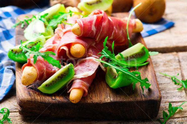 Prosciutto and kiwi.selective focus. Stock photo © zoryanchik