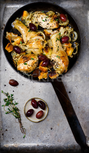the baked chicken on a frying pan . Stock photo © zoryanchik