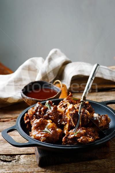 Barbecue carne di maiale rustico cena rosso piatto Foto d'archivio © zoryanchik