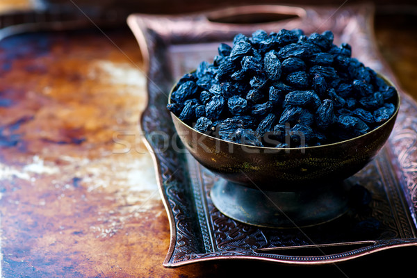 dried dark raisin in oriental metal ware Stock photo © zoryanchik