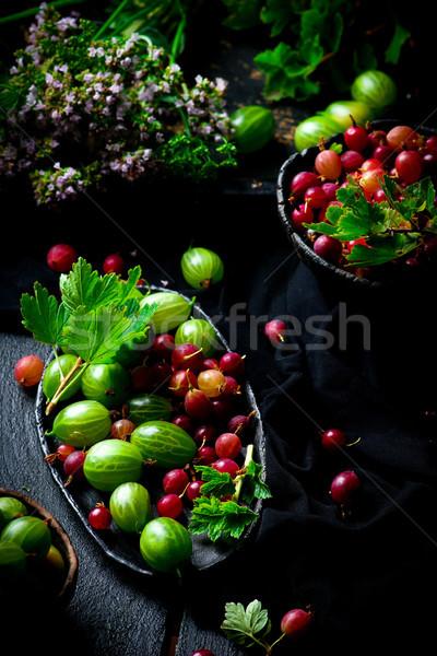 Fresh,organic gooseberry in ceramic bowl Stock photo © zoryanchik
