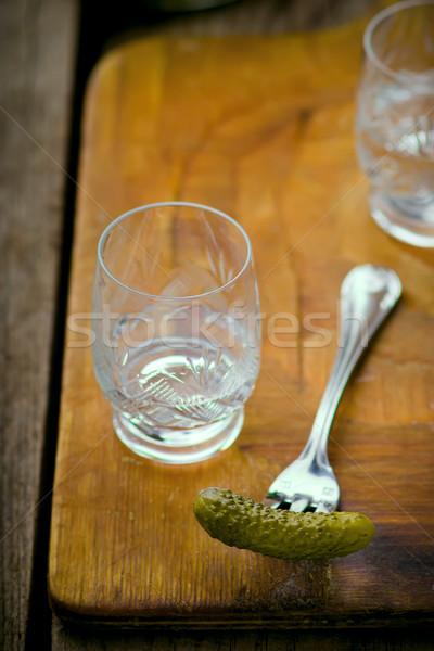 Concombres vodka verre concombre fourche planche à découper Photo stock © zoryanchik
