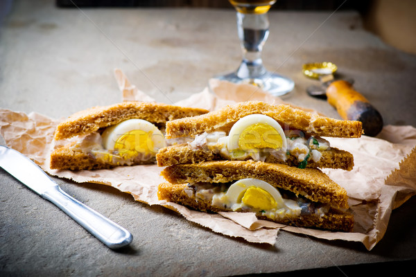 sandwich with a herring and eggs  Stock photo © zoryanchik