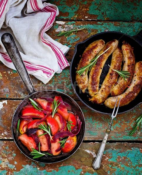Frito salsichas maçãs cebolas alecrim frigideira Foto stock © zoryanchik