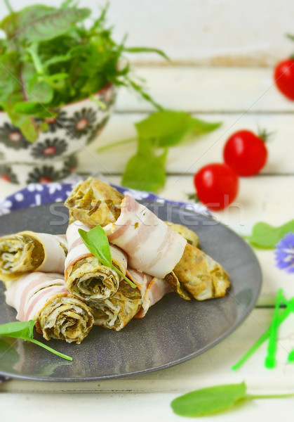 Rolls from an omelet with a sorrel and bacon Stock photo © zoryanchik