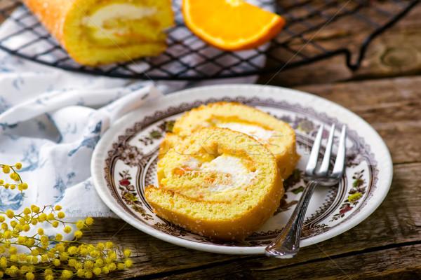Rolar chantilly laranja creme estilo rústico Foto stock © zoryanchik