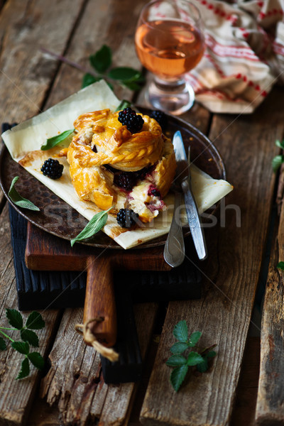 Baked brie with blackberry in puff pastry.style rustic Stock photo © zoryanchik