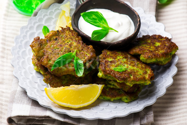 Broccoli Fritters with yogurt sauce. Stock photo © zoryanchik