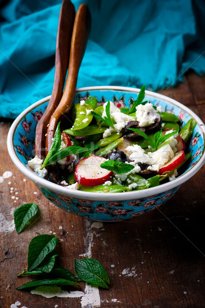 Spring Radish And Snap Pea Greek Salad..style rustic.selective focus Stock photo © zoryanchik