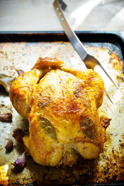 the chicken baked entirely on a baking sheet  Stock photo © zoryanchik