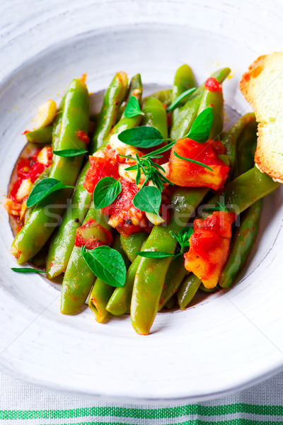 green beans, stewed with tomatoes. Stock photo © zoryanchik