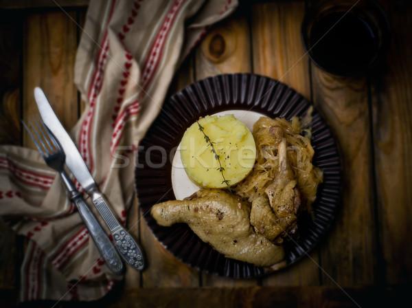 Confit from a duck, stewed sauerkraut and mashed potatoes.  Stock photo © zoryanchik