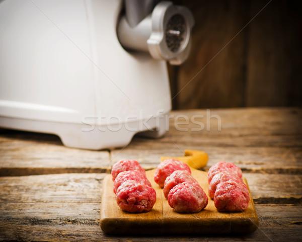 Raw meat balls on a chopping board.  Stock photo © zoryanchik