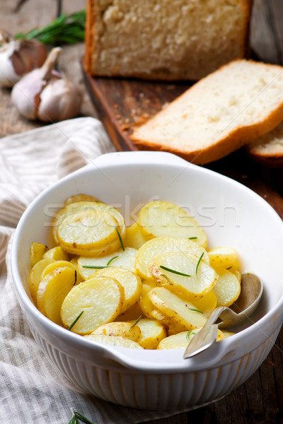 Stock photo: Baked new  potato with herbs .style rustic
