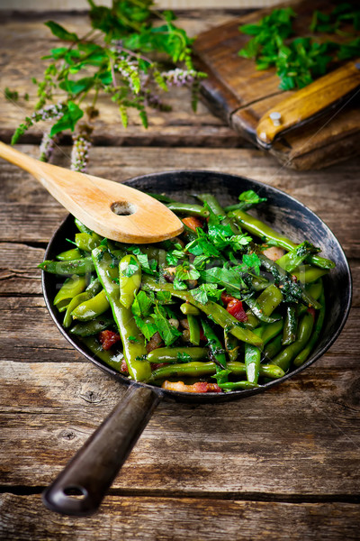 Stock photo: green beans, stewed with panchetta