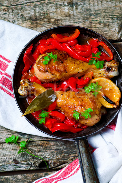 chicken drumsticks with a pepper  in a frying pan. Stock photo © zoryanchik