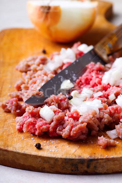 Force meat with onion on the cutting board  Stock photo © zoryanchik