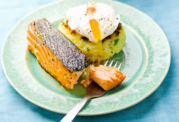 the fried salmon with a potato patty and poached egg  Stock photo © zoryanchik