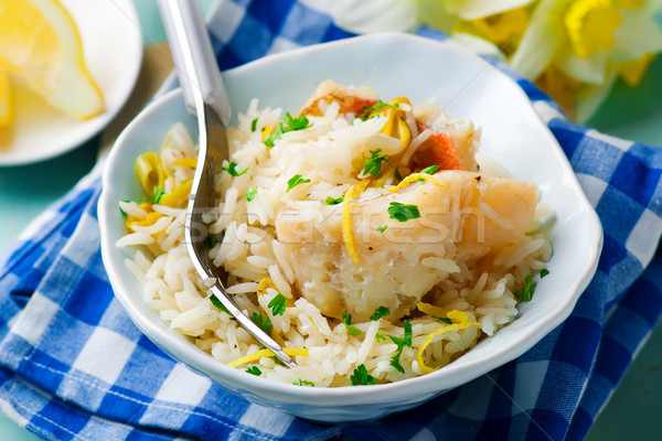 rice with fish and a leek in ceramic bowl Stock photo © zoryanchik