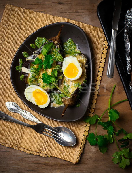 the baked eggplants with egg and two sauces Stock photo © zoryanchik