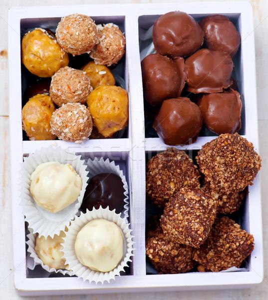 all sorts of handmade bonbons  in a box.  Stock photo © zoryanchik