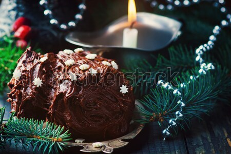 Yule log on a Christmas background. Stock photo © zoryanchik