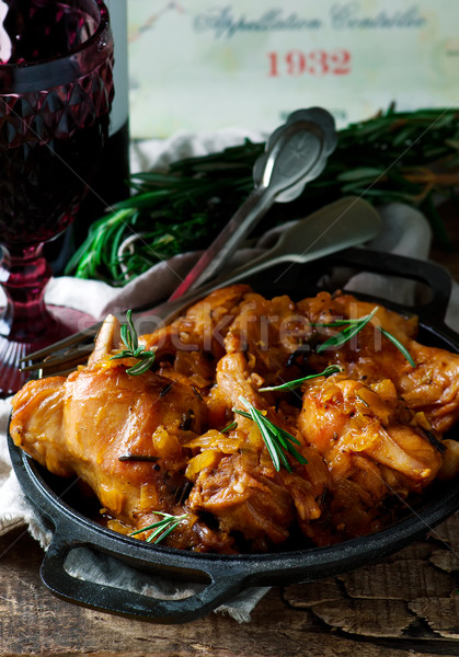 Braised rabbit  with rosemary Stock photo © zoryanchik