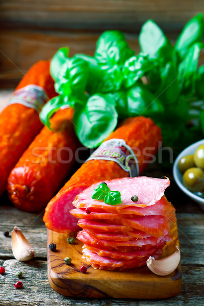 The cut salami sausage on a chopping board Stock photo © zoryanchik