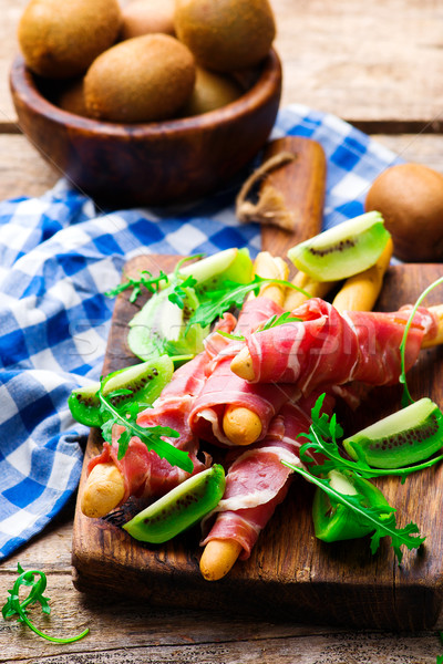 Prosciutto and kiwi.selective focus. Stock photo © zoryanchik