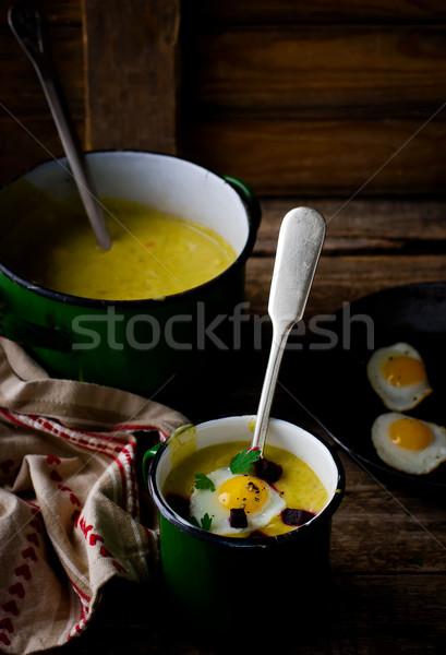 potato soup - mashed potatoes with fried eggs  Stock photo © zoryanchik