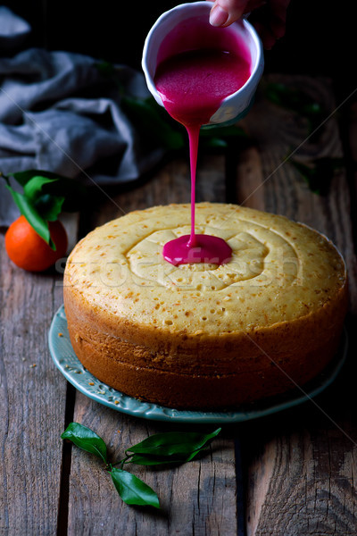 tangerine bundt cake with pomegranate glaze..selective focus Stock photo © zoryanchik