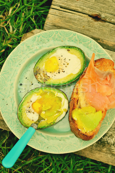 Baked eggs in avocado Stock photo © zoryanchik