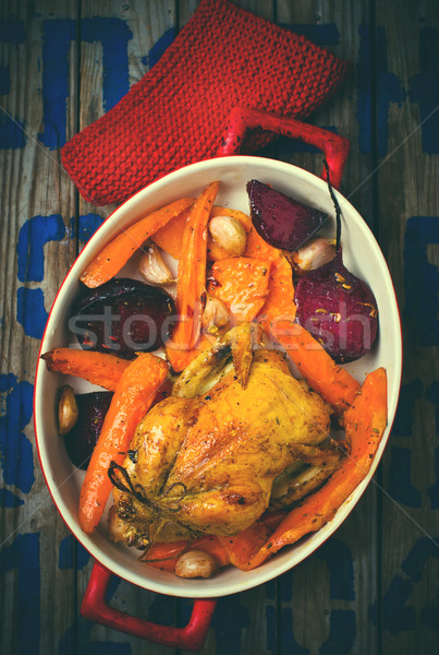 The chicken baked with root crops.  Stock photo © zoryanchik