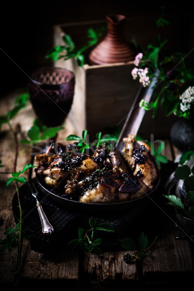 Quail with blackberry sauce.darck rustic photo Stock photo © zoryanchik